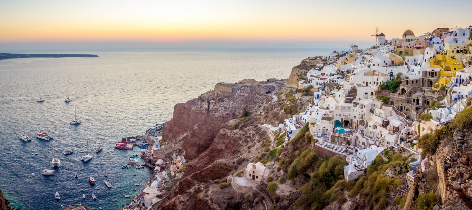 Santorini seascape at sunset. Santorini, Greece, is an ancient volcano located in the middle of the mediterranean sea, surrounded by crystalline and refreshing stock images
