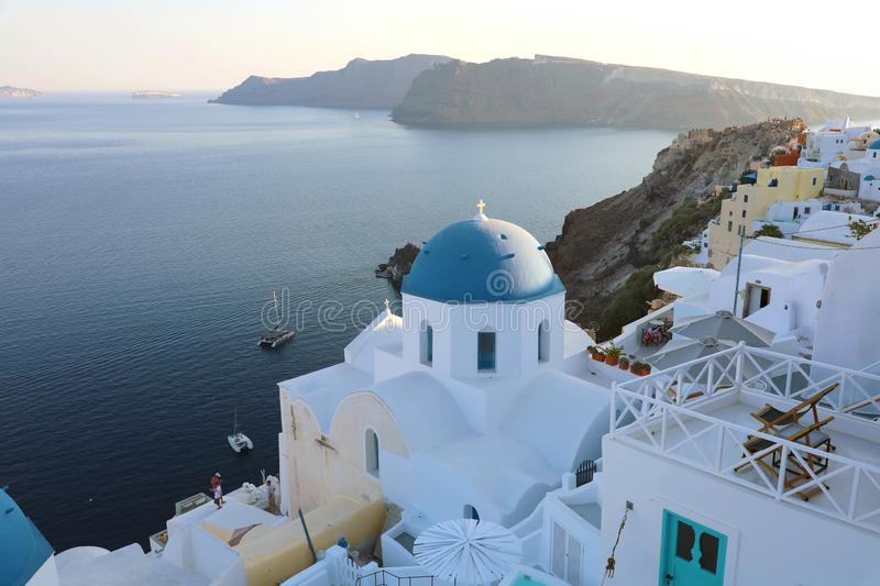 Santorini traditional greek white village with blue domes of churches, Greece.  stock image