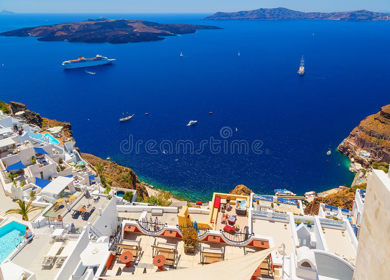Santorini volcanic caldera as seen from Fira, capital of Santorini, Greece. Hotels with vacationing tourists stock photography