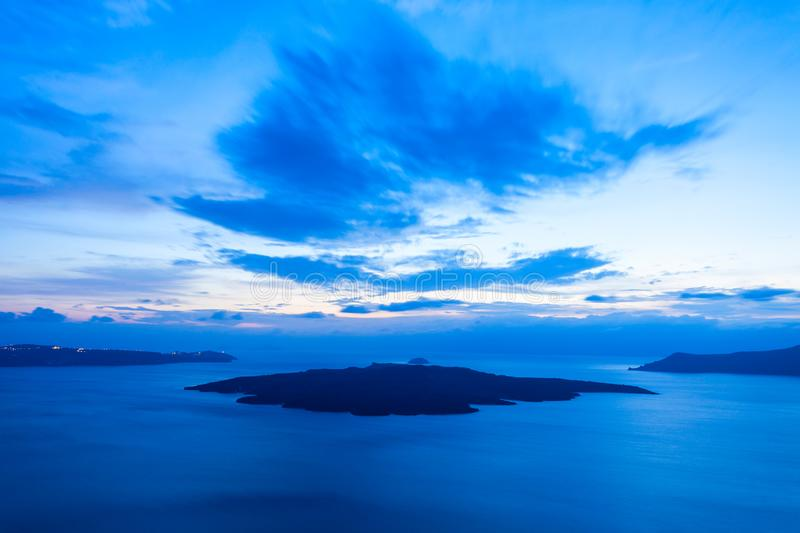 Santorini volcano caldera, Greece. Santorini volcano caldera located in the southern Aegean Sea at sunset. Volcano consisting of Santorini main island, Therasia stock photography