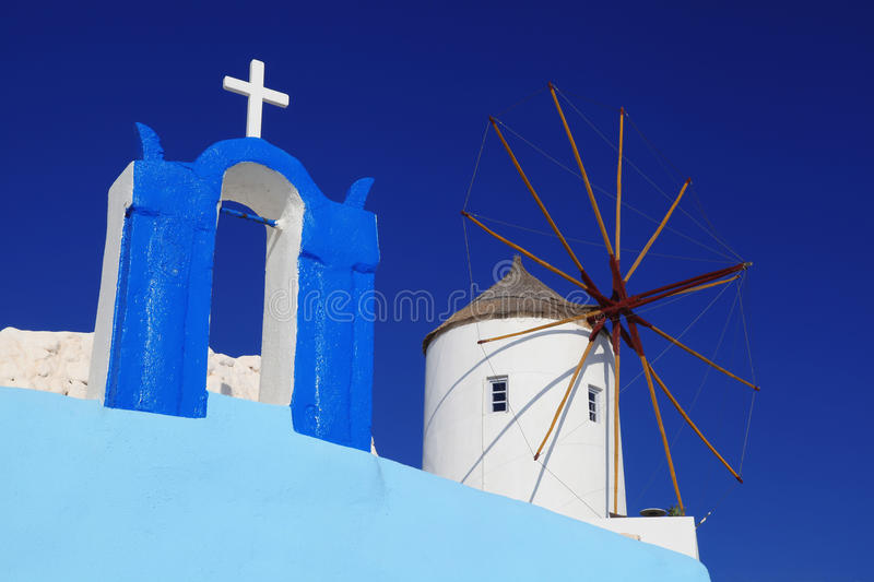 Santorini with windmill in Oia, Greece stock images