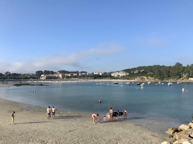 Sanxenxo, Pontevedra / Spain - July 25 2018: View of people on the beach of Baltar in Portonovo during a day of summer royalty free stock image