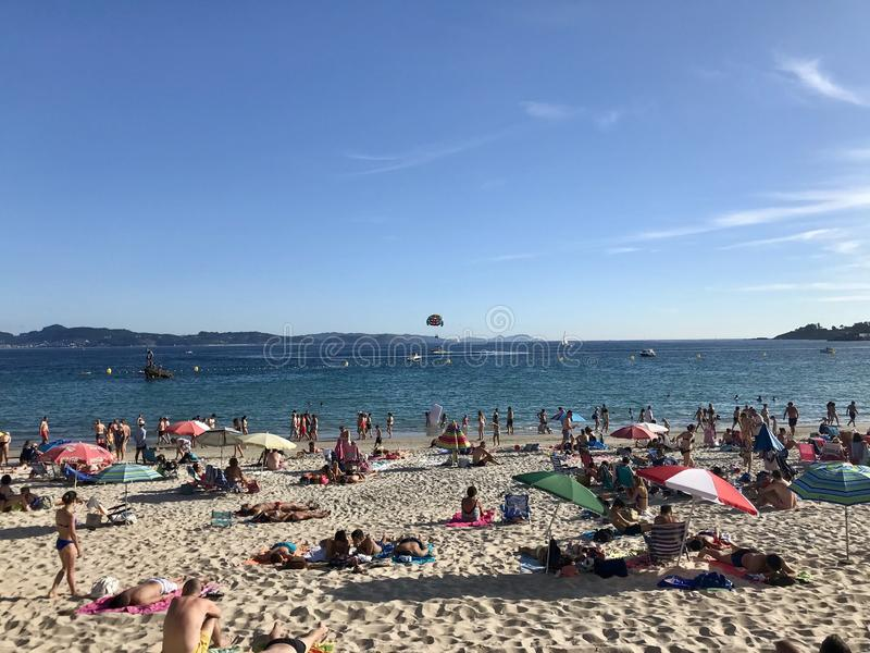 Sanxenxo, Pontevedra / Spain - July 26 2018: View of people on the beach of Silgar during a day of summer royalty free stock photos