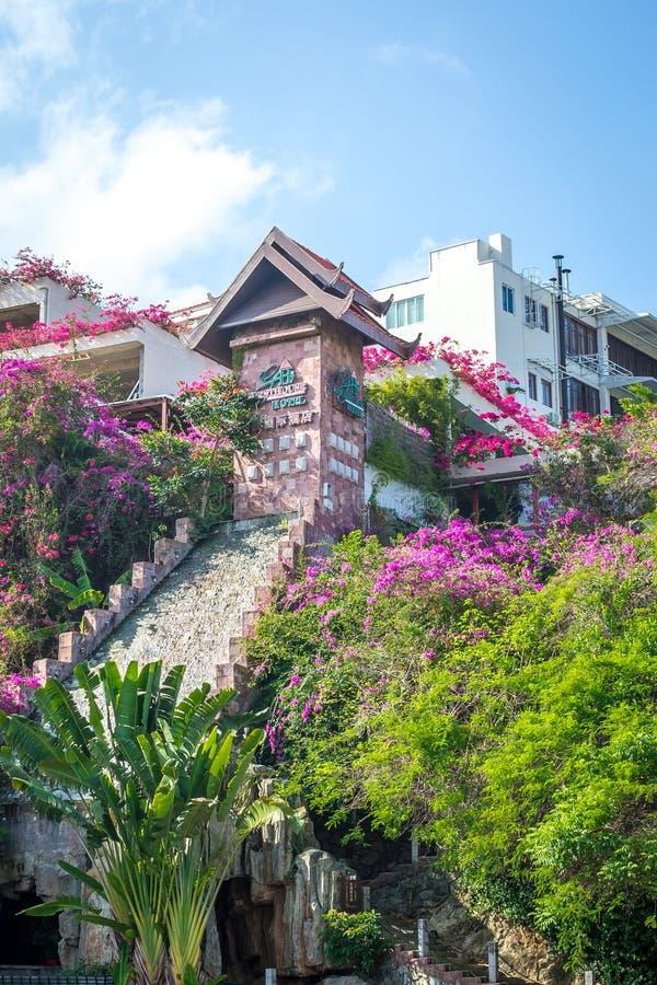 Sanya, Dadonghai Bay, Hainan, China - 16 May, 2019: View of Guesthouse International Hotel from the street Yuya Road stock photos