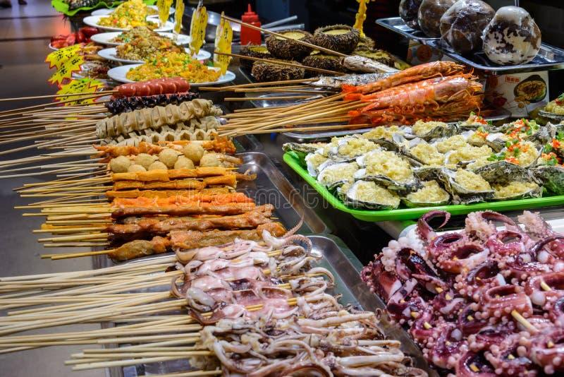 Chinese street food. Street trading. Chinese kinds of fresh seafood at an asian seafood market in Sanya, Hainan province, China. Sanya, Hainan/China - January 7 royalty free stock images