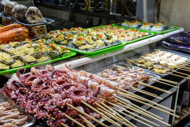 Chinese street food. Street trading. Chinese kinds of fresh seafood at an asian seafood market in Sanya, Hainan province, China. Sanya, Hainan/China - January 7 stock photos