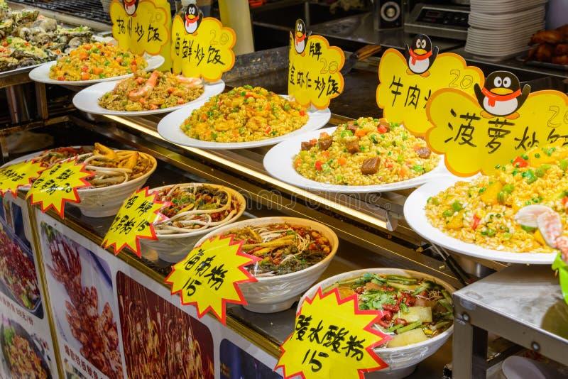 Chinese street food. Street trading. Chinese kinds of fresh seafood at an asian seafood market in Sanya, Hainan province, China. Sanya, Hainan/China - January 7 royalty free stock photos