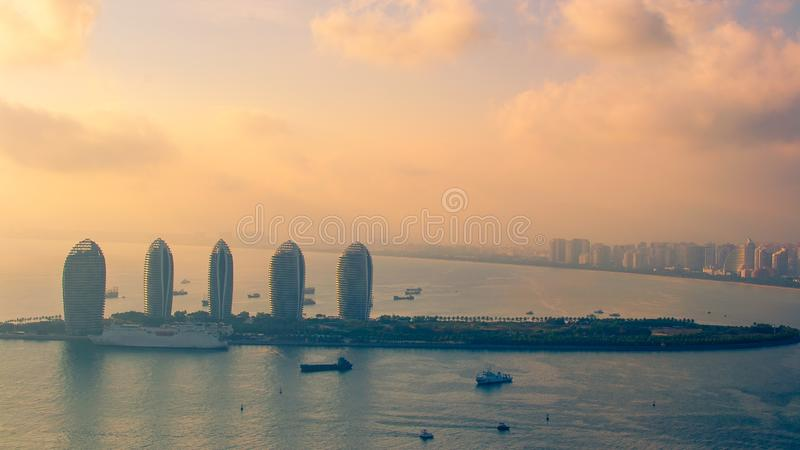 Sanya, Hainan island, China. View of Sanya Phoenix Island from Luhuitou Park. Sunset, blur, haze.  stock photo