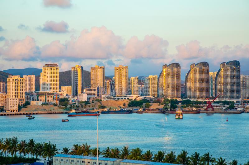 Sanya town evening cityscape, view from Phoenix island on Hainan Island of China stock photography