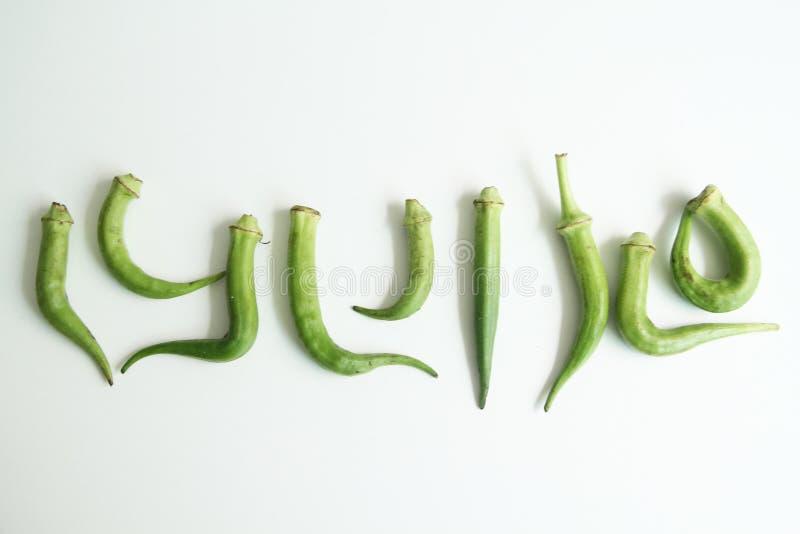 Sao branco isolado gráfico Paulo Brazil do alimento do fundo dos símbolos do quiabo imagens de stock royalty free