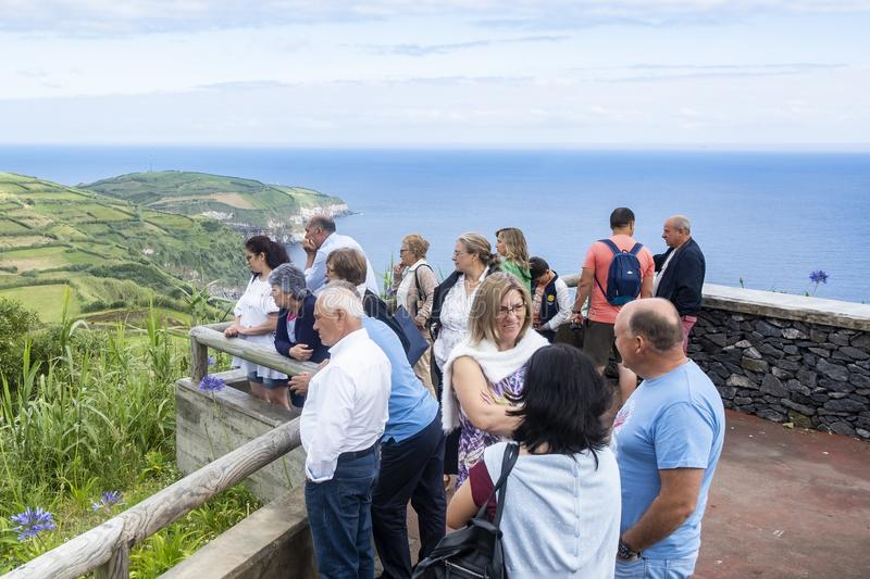 Sao Miguel Island, Azores - June 24, 2019: A Group of European Tourists Admiring the Beautiful Scenery of the Green Rolling Hills royalty free stock photo