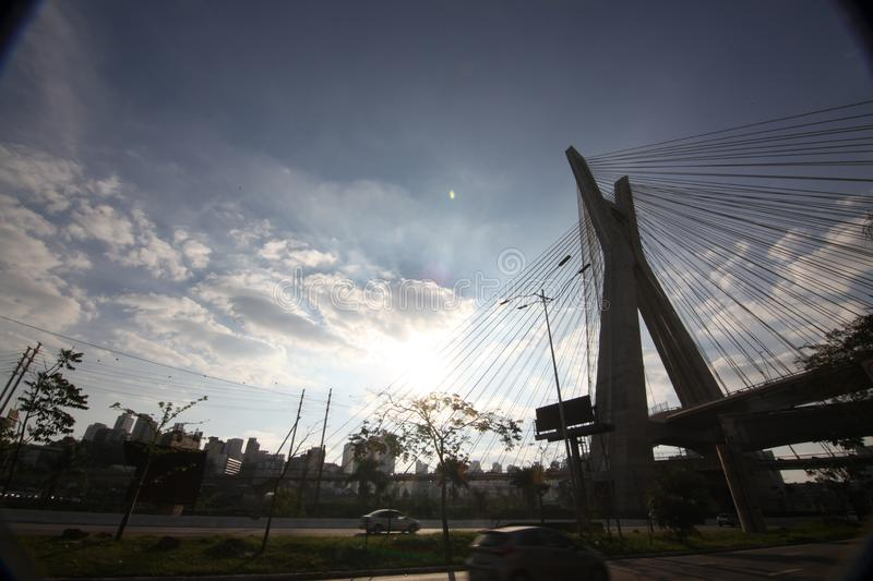 Sao Paulo-BRAZIL / Beautiful Cityscape with a cars, motorbikes and traffic on highway road with blurred cars light trails. Beautiful Cityscape with a cars royalty free stock images