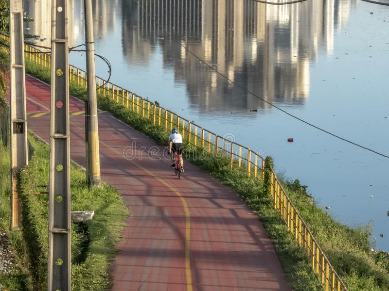 Cyclist on bicycle Lane near of Pinheiros River royalty free stock photography