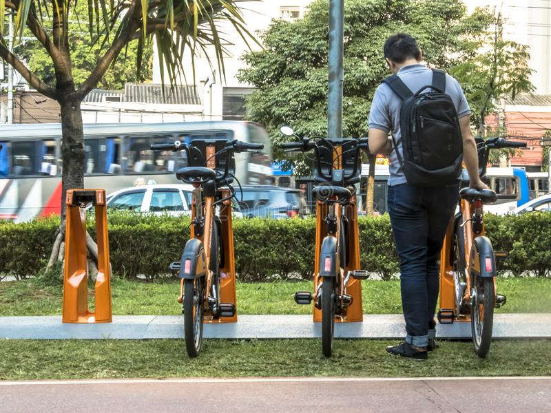 Users access the APP for Urban bikes for hire in Tembici Station of Bike. Sao Paulo, Brazil, December 14, 2018. users access the APP for Urban bikes for hire in royalty free stock photo