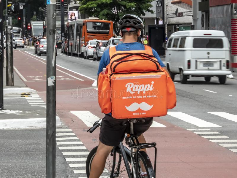 worker Rappi app on the bicycle delivers food stock images