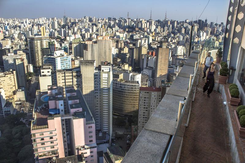Sao Paulo, Brazil. May 03, 2013. Traveler looking on a big city, travel and active lifestyle concept. Tourist enjoy panoramic view of city, on the terrace of stock images