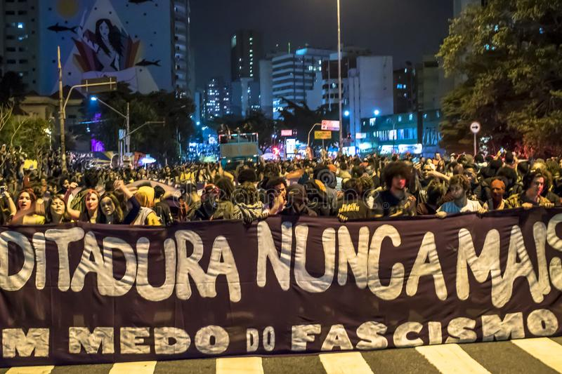 A group of people participates in a demonstration against President-elect Jair Bolsonaro. Hundreds of Brazilians, mostly students,. Sao Paulo, Brazil, 30 October stock images