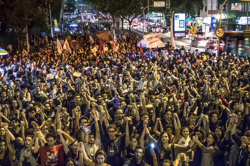 A group of people participates in a demonstration against President-elect Jair Bolsonaro. Hundreds of Brazilians, mostly students,. Sao Paulo, Brazil, 30 October royalty free stock image