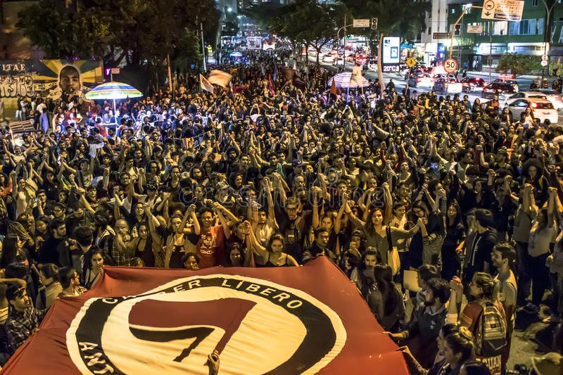 A group of people participates in a demonstration against President-elect Jair Bolsonaro. Hundreds of Brazilians, mostly students,. Sao Paulo, Brazil, 30 October stock photo