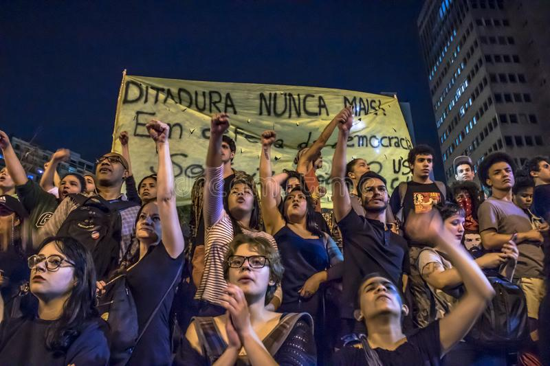 A group of people participates in a demonstration against President-elect Jair Bolsonaro. Hundreds of Brazilians, mostly students,. Sao Paulo, Brazil, 30 October stock photos