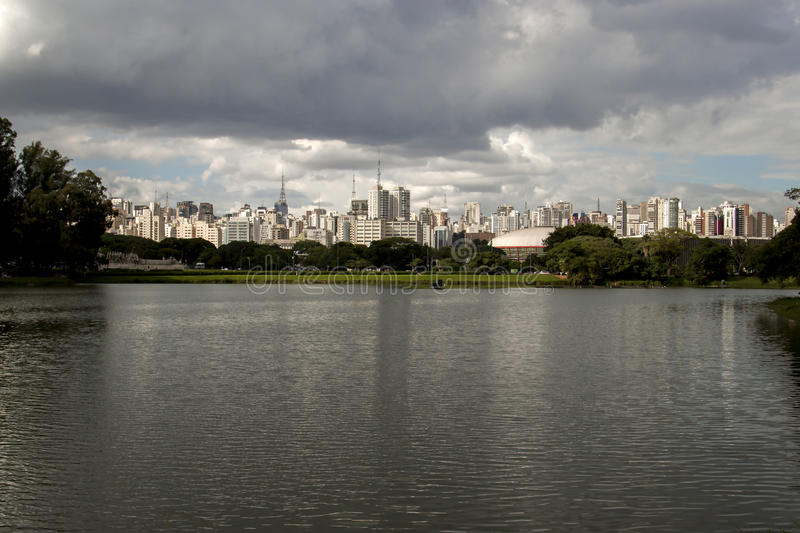 Sao paulo buildings cityscape viewed from Ibirapuera park with lake and trees stock images