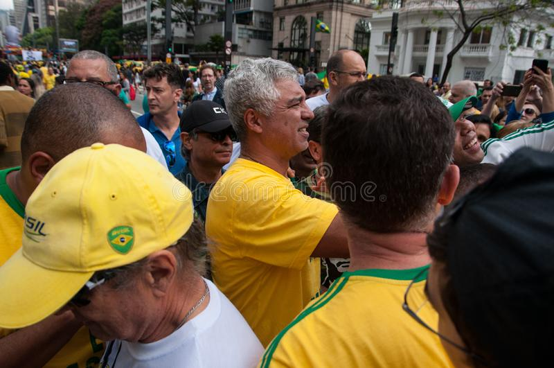 2018/10/21 - Sao Paulo, SP, Brazil - Demonstrartion pro presidential candidate Jair Bolsonaro on Av Paulista. Major olimpio surrounded by supporters taking stock images