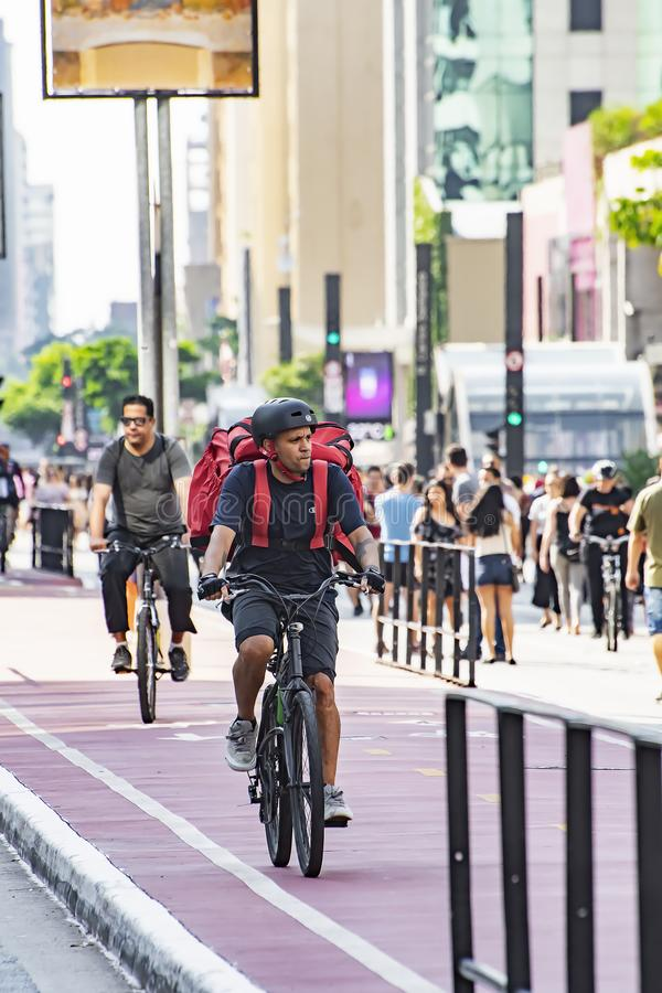 Bike delivery man at Paulista avenue stock image