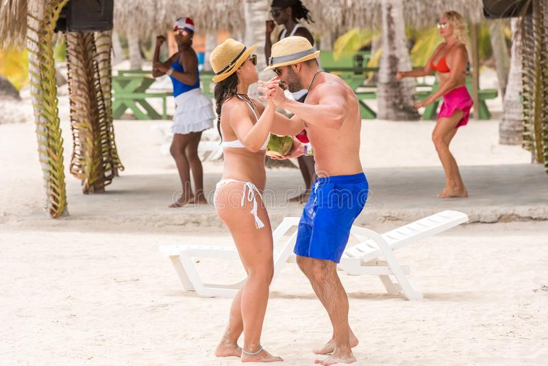 SAONA, DOMINICAN REPUBLIC - MAY 25, 2017:Dancing on the beach of the island in sunny weather. Copy space for text. SAONA, DOMINICAN REPUBLIC - MAY 25, 2017 stock photos
