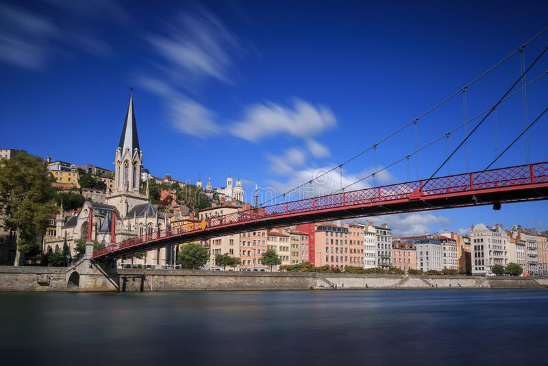Saone and Lyon. Passerelle footbridge Saint Georges over the Saone river and the Saint Georges church in Lyon, France stock images