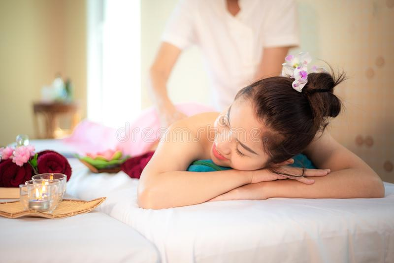 Sap Massage. Masseur doing massage with treatment sugar scrub on Asian woman body in the Thai spa lifestyle, so relax and luxury royalty free stock image