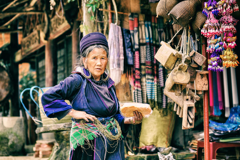 Sapa, Lao Cai, Vietnam - 29 December,2012: Old woman stand at her shop. Sapa is one of the famous location in North Vietnam stock photo