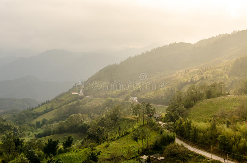 Sapa valley city in the mist in the morning, Vietnam stock photography