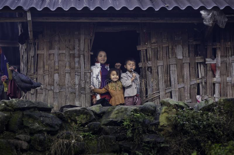 Happy family in sapa. SAPA, VIETNAM – DECEMBER 13: The hill tribe people greet the people who passed by with a bright smile on December 13, 2017 in Sapa stock photography