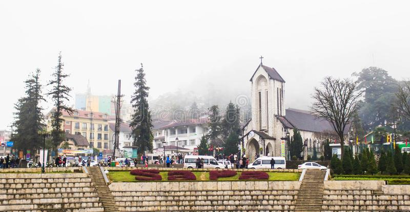 SAPA, VIETNAM - JAN 1 2018: Stone Church at downtown in Sapa, Vietnam. Sapa is a beautiful, mountainous town in northern Vietnam a. Long the border with China stock images
