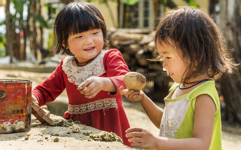 Two girls playing outside their house in sapa, Vietnam stock image