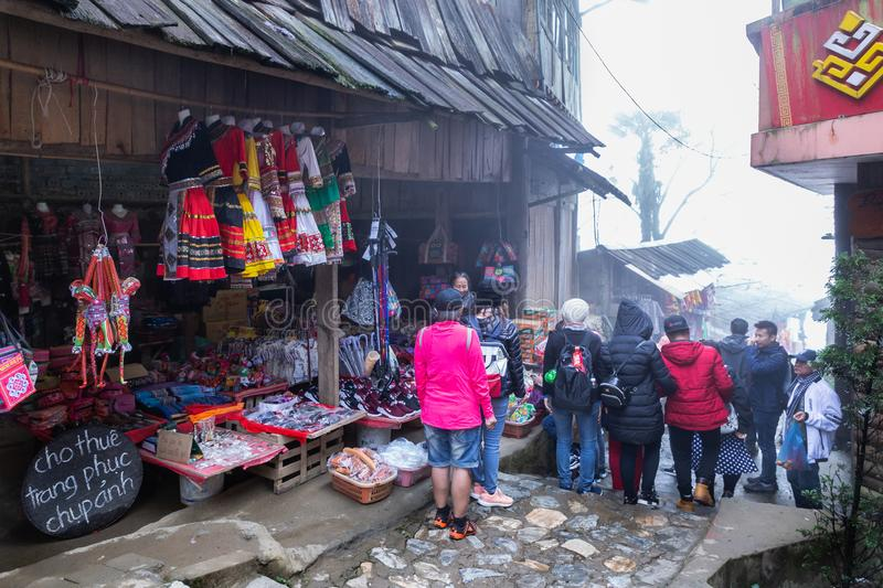 View of people traveling at Cat Cat village, in the rainy and foggy morning Laocai province, Sapa, Vietnam. royalty free stock photo