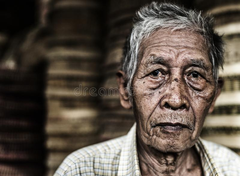 Old man selling basket in local market in Sapa, Vietnam royalty free stock images