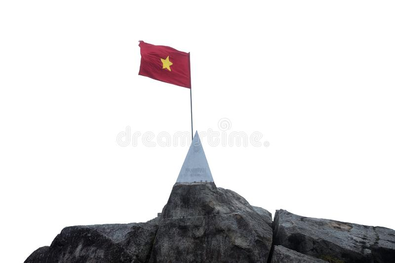 Sapa, Vietnam - Sep 08 2017 : On top Fansipan mountain with flag vietnam waving and monument on stone at 3143m stock image
