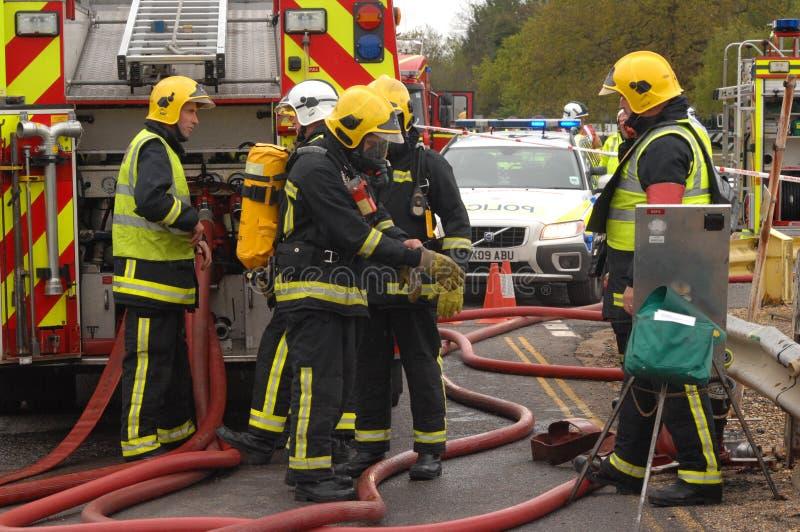 Sapadores-bombeiros em um incidente foto de stock