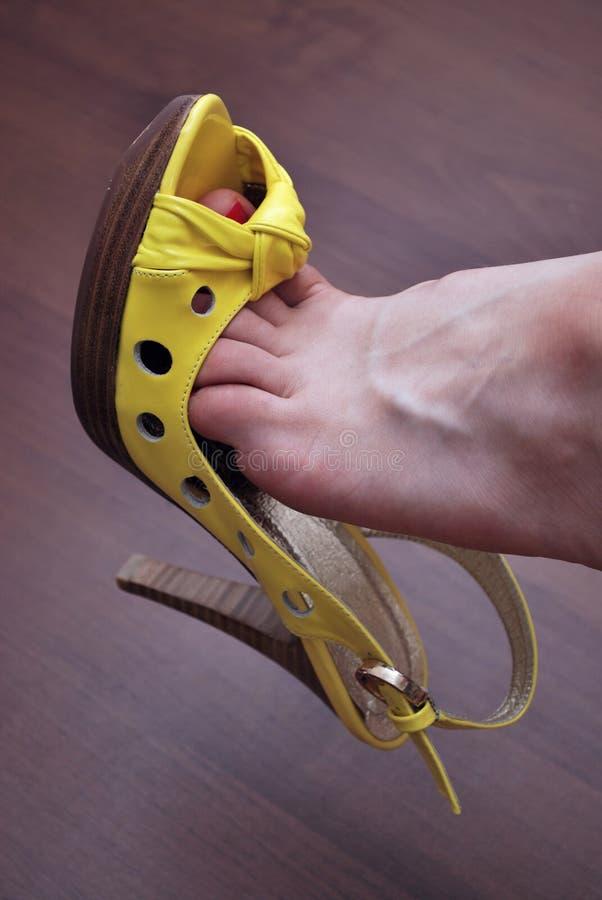 Sapata amarela 'sexy' fotografia de stock