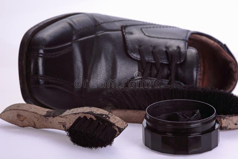 Sapata e sapatas que limpam o jogo imagem de stock