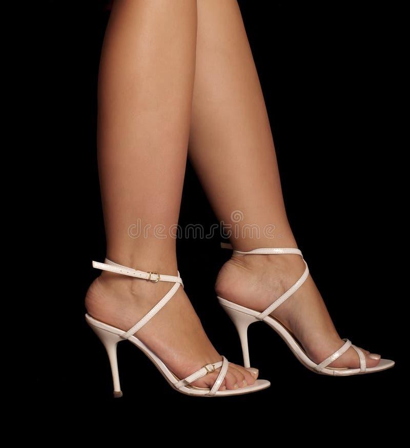 Sapatas brancas, pés 'sexy' imagem de stock