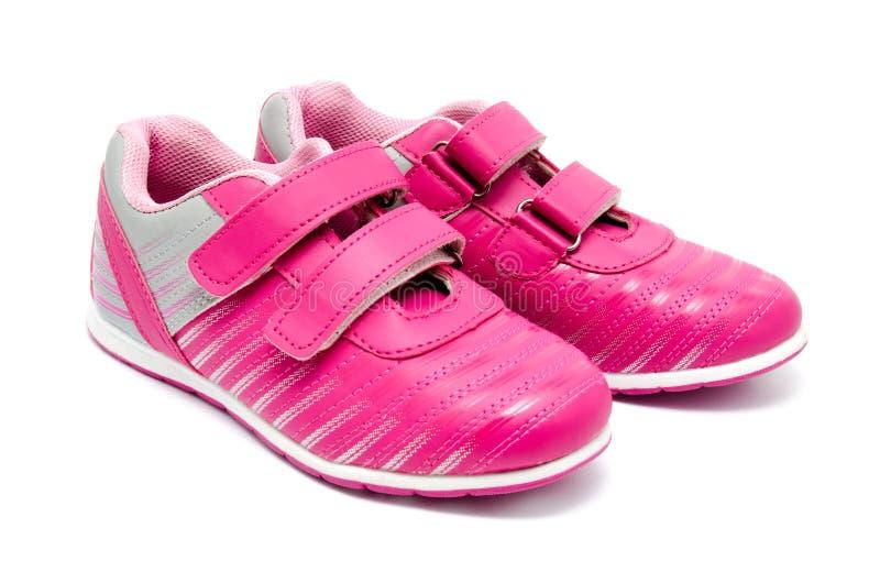 Sapatas cor-de-rosa do esporte das crianças isoladas imagens de stock