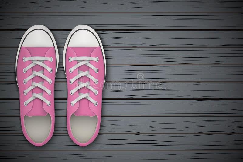 Sapatas cor-de-rosa dos gumshoes no fundo de madeira ilustração royalty free