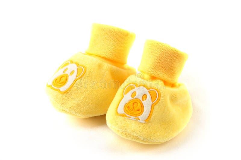 Sapatas de bebê amarelas imagem de stock