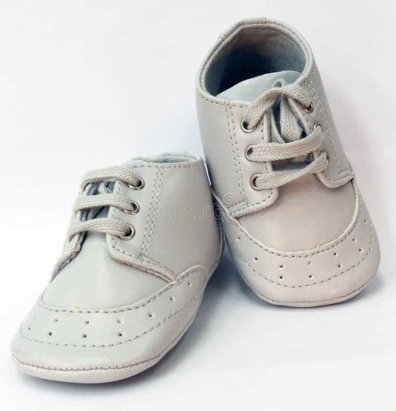 Sapatas de bebê cinzentas imagem de stock