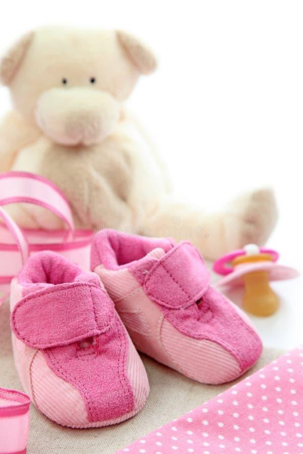 Sapatas de bebê cor-de-rosa imagens de stock