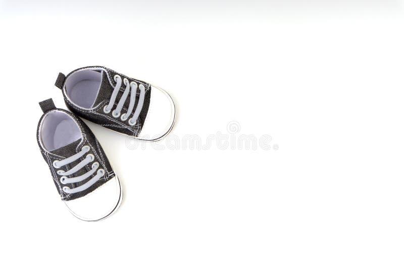Sapatas de beb? no fundo branco fotos de stock royalty free