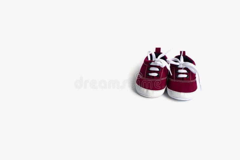 Sapatas de beb? vermelhas foto de stock royalty free