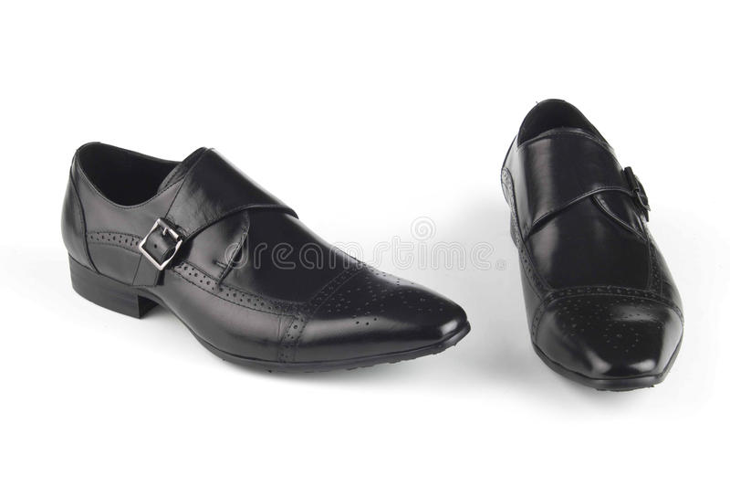 Sapatas de couro da cor preta fotografia de stock royalty free